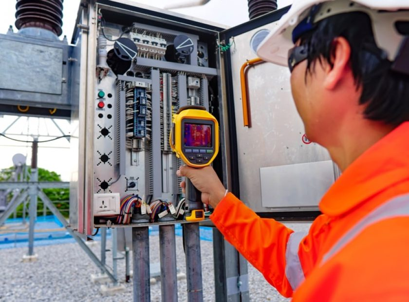 Electrical engineers used a thermometer to check for faults in equipment sets, Also known as preventive maintenance to reduce the damage of equipment, Concept to professional engineer on industrial